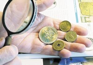 Как определить фальшивую монету